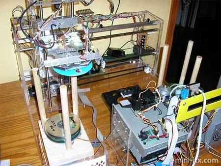 Automatismo de replicación de CD y DVD casero